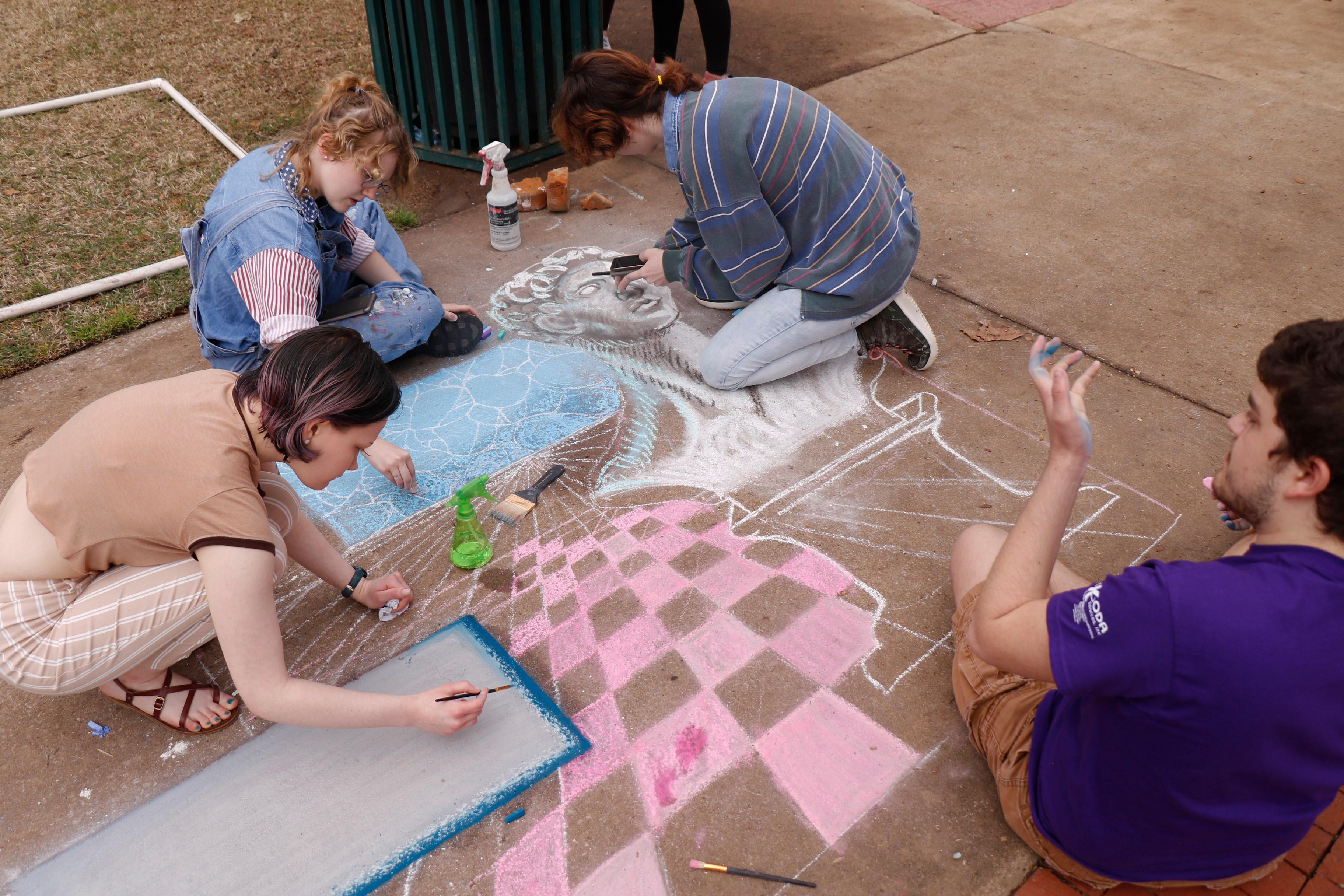 Students working on chalk art