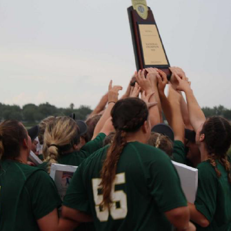 usao softball girls holding up national championship trophy