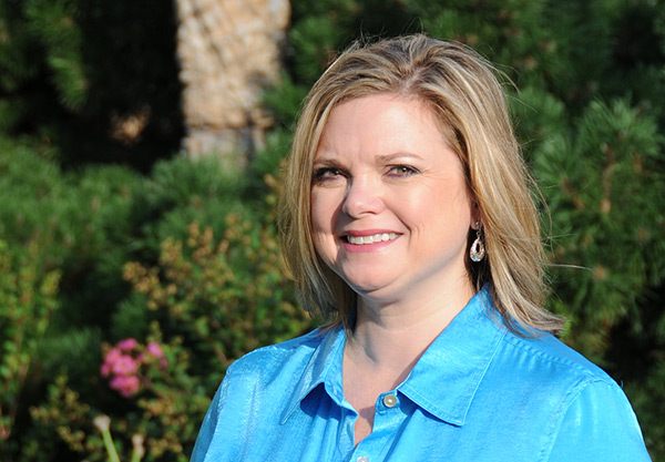 head shot of new communications director, Kelly Arnold