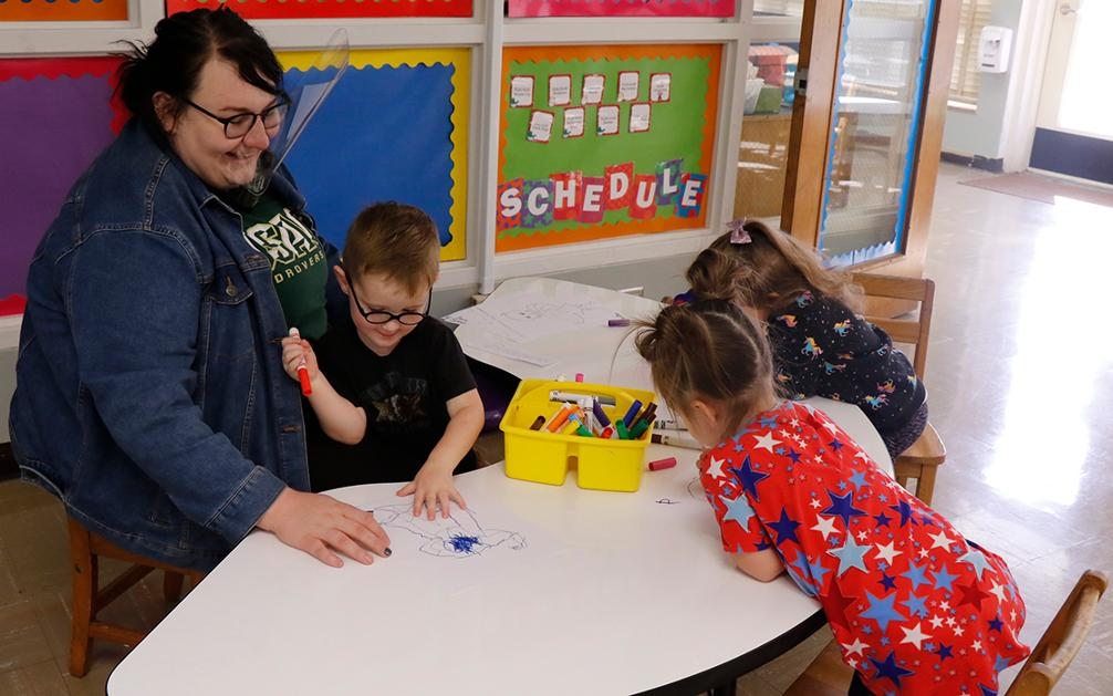 One of USAO's teachers-in-training working with students in the Child Development Center